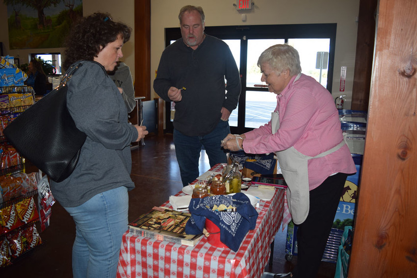 Customers sample delectable cheese at Kathy's Korner in honor of its one-year anniversary.