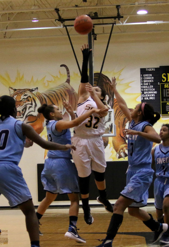 Jaymi Gordon sets up for a shot in the comeback win over Sweeny. Gordon, a senior this year, led the Lady Tigers in scoring during their last campaign.