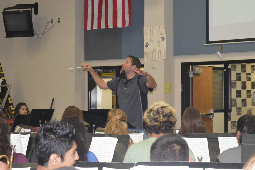 Sealy band instructor Roland Cantu conducts a song at practice.