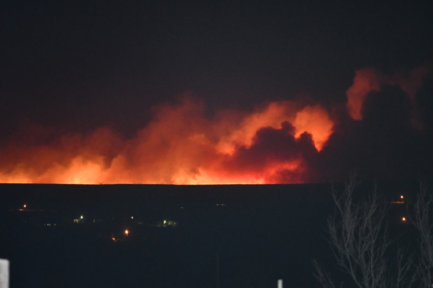 The flames from the Old Muddy Road wildfire in Potter County can be seen from the edge of Amarillo, 15 miles away.