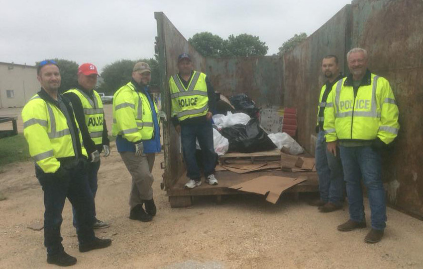 Officers with the Sealy Police Department helped pick up trash as temperatures dipped into the low 50s Saturday morning.