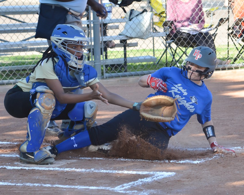 Reagan Majewski Jr. slides into home and is safe.