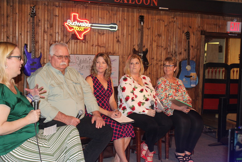 Sealy News managing editor April Towery interviews Sealy City Council candidates during a public forum April 18 at Saddleback Saloon. Candidates pictured from left are Larry Koy, Jennifer Sullivan, Mischelle McCarthy and Diane Wuthrich.