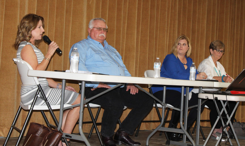 Sealy City Council candidates, from left, Jennifer Sullivan, Larry Koy, Mischelle McCarthy and Diane Wuthrich discuss issues during a candidate forum last week.