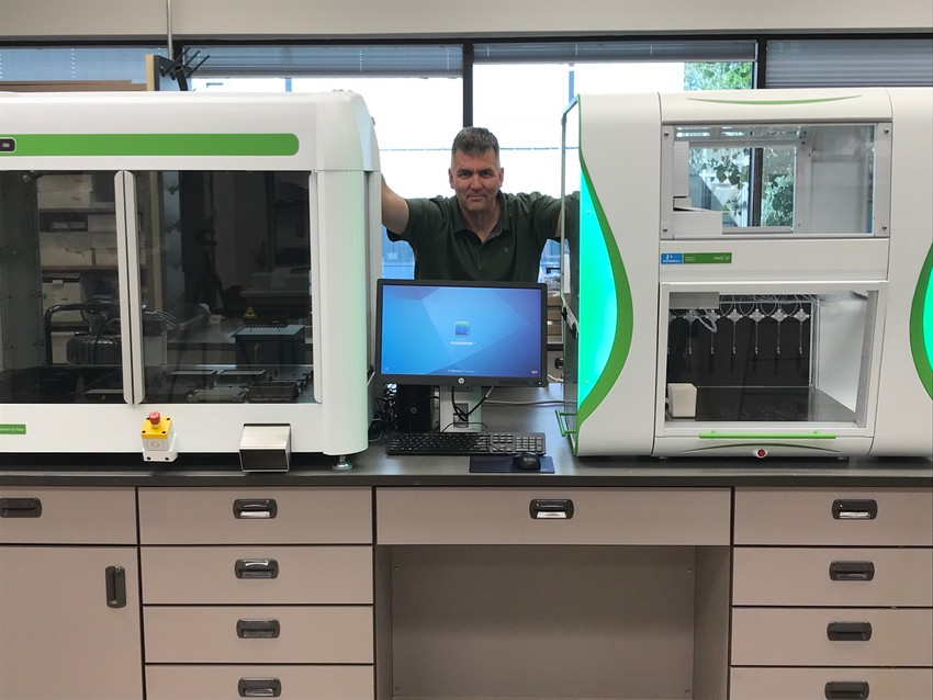 Dr. Charlie Johnson, director of the Texas A&M AgriLife Research Genomics and Bioinformatics Service facility, shows off the new equipment.