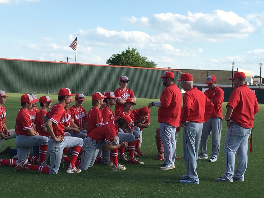 Head Coach Jeff Durbin addresses the Bellville baseball team after they finished their sweep of Brazosport in the first round of the playoffs.