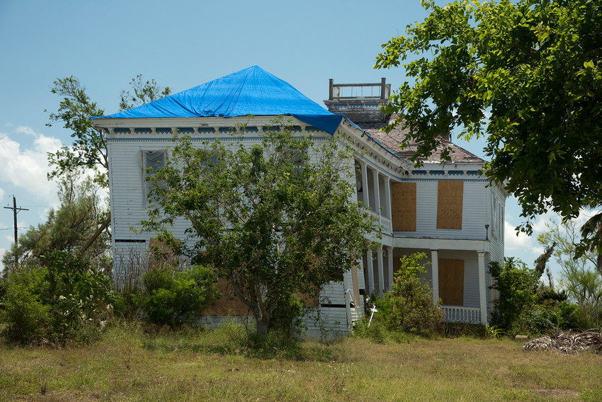 A house in Bayside, near Rockport, twisted by the force of Hurricane Harvey last September, shows the effects of 150-plus mph winds. Blue tarps covering damaged structures and boarded-up windows still exist throughout the Coastal Bend as recovery is ongoing, but the area is open for business.