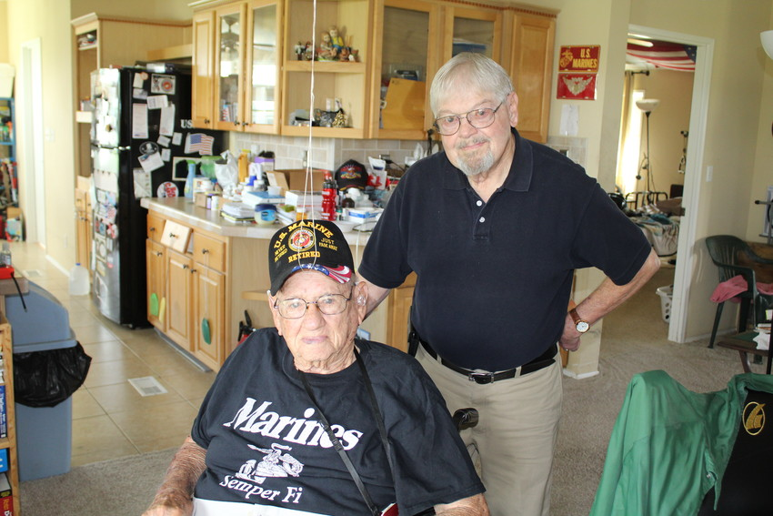 Buddy Chance, executive director of Helping One Another-Meals on Wheels, visits retired U.S. Marine Richard Reynolds, left, every weekday.