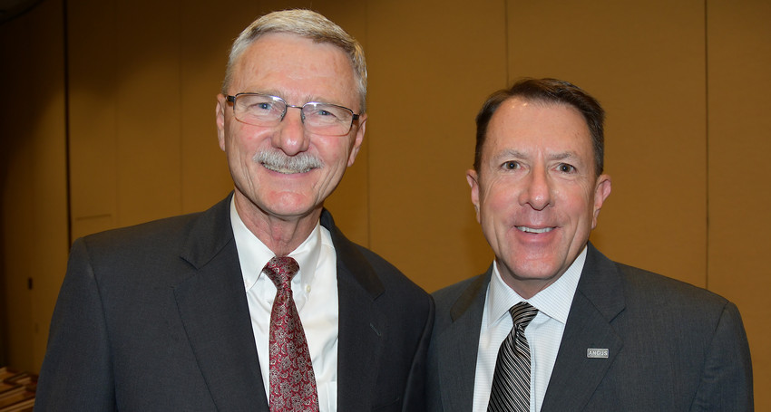 Dr. Jim Mazurkiewicz, Texas Agricultural Lifetime Leadership program director, and Allen Moczygemba, chief executive officer of the American Angus Association and TALL III alumnus, at the TALL XV graduation ceremonies in College Station.