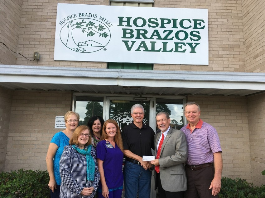 Austin County Cruisers president Bob Dormois, along with Danny Jacob, right, recently presented a check for $2,000 to Hospice Brazos Valley CEO Craig Borchardt. The Cruisers are able to present local non-profit organizations with funds raised from the annual car show held each March on the historical Bellville Square. Also pictured, from left, are Hospice Brazos Valley staff members Brenda Schultz, Debra Johnson, Ruth Supak and Jenny Schoen.