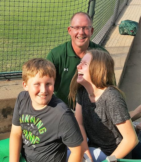 Brenham baseball pitcher Jon Peters shares a laugh with his kids, Jake and Kylie.