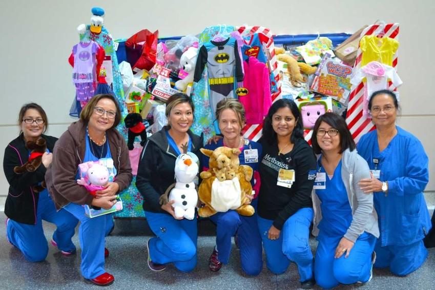 Flu shot toy drive volunteers gather at Houston Methodist.