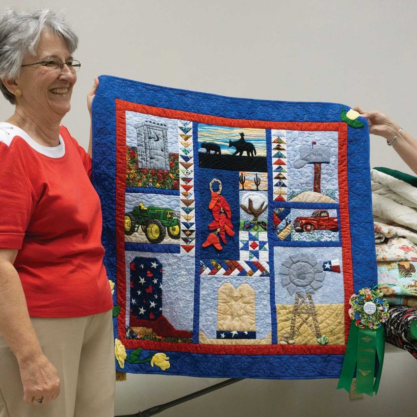 This quilt is a small version of the 2017 donation quilt that Laura North and others made for BBQG Quilt Guild in Brenham.