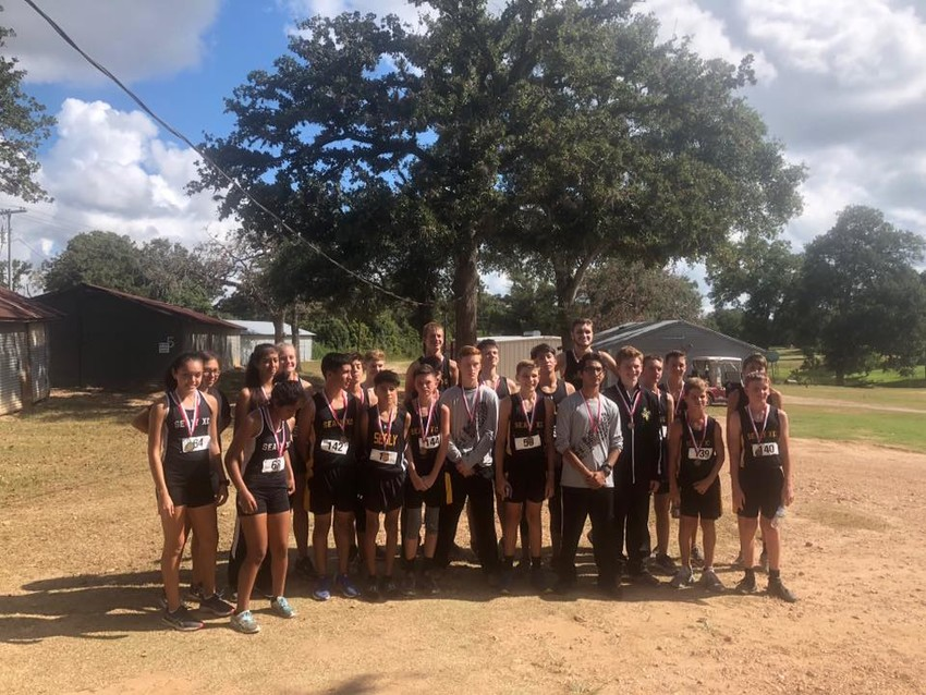 The Tigers show off their hardware after the Bellville Meet Saturday morning