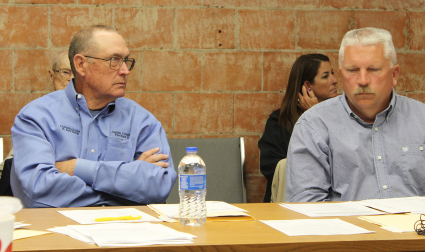 Commissioners Randy Reichardt and Doug King deliberate matters during a meeting of Austin County Commissioners Court.