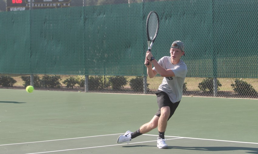 Junior Justin DeLozier won his singles match when Sealy and Needville first clashed back on Sept. 6