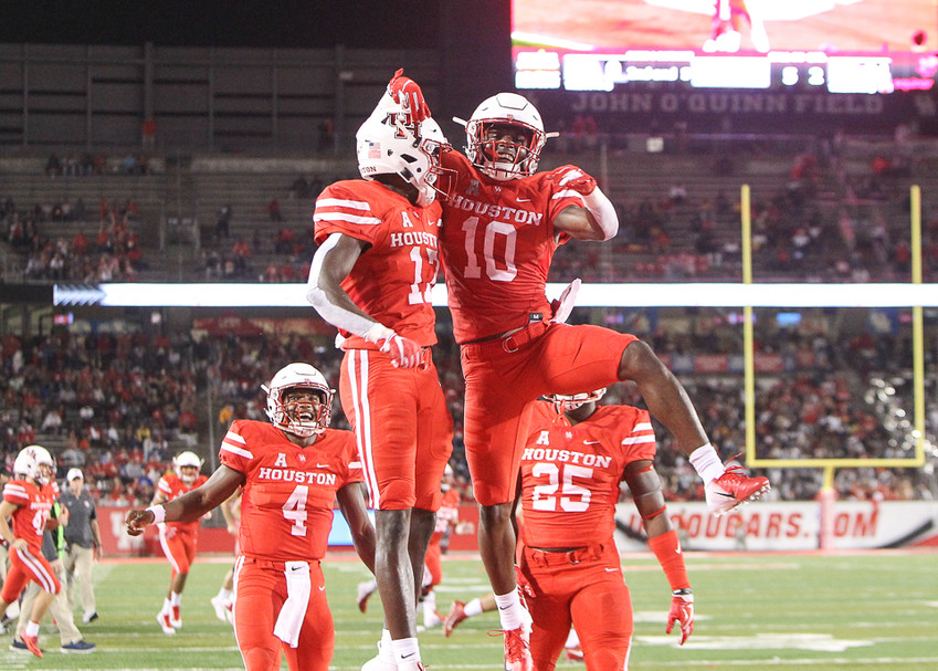 The Houston Cougars celebrate after a touchdown in the first half of an NCAA football game between the Houston Cougars and the Texas Southern Tigers on Saturday, Sept. 22, 2018 in Houston, Texas.