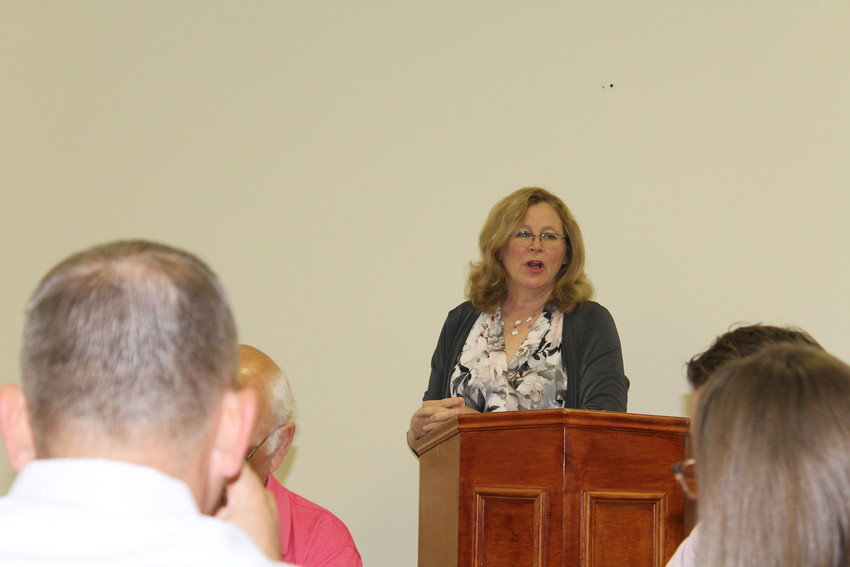Sealy Mayor Janice Whitehead addresses a large crowd during a Chamber of Commerce luncheon at Backdrop Events.