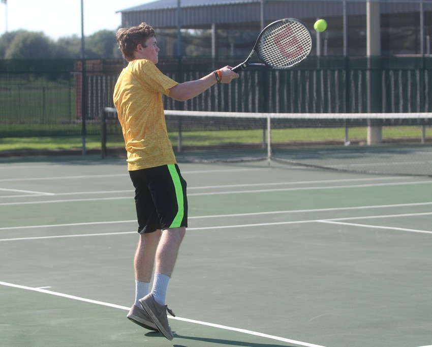 Austin Keeton was the sole bright spot on the boys' singles side, earning a 6-2 decision in a lightning-shortened match.
