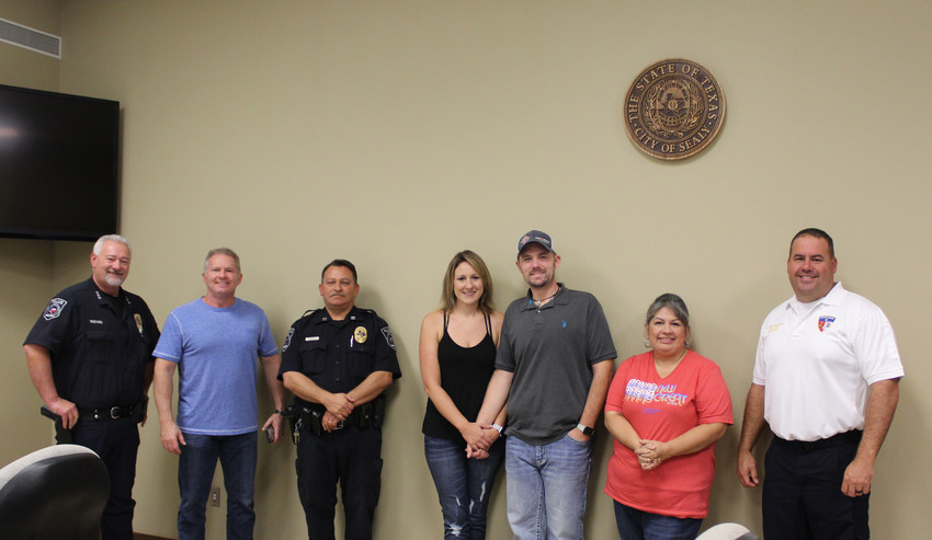 From left are Police Chief Jay Reeves, Christian City Fellowship Pastor Rusty Griffin, Capt. Chris Hudson, Kim Bryant, K9 Officer Eric Bryant, Debby Barron and Fire Chief Kenny Willingham. They all served on this year's National Night Out planning committee.