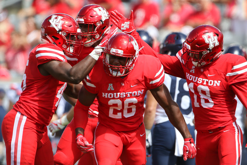 Teammates congratulate Houston Cougars wide receiver Ja'Kori Morgan (26) after a touchdown during an NCAA football game between Houston and Arizona on Saturday, Sept 8, 2018 in Houston, Texas.