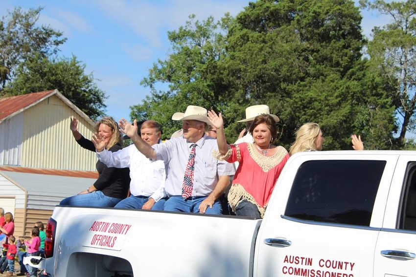 Austin County officials wave to the crowd at the annual fair parade held Oct. 11.