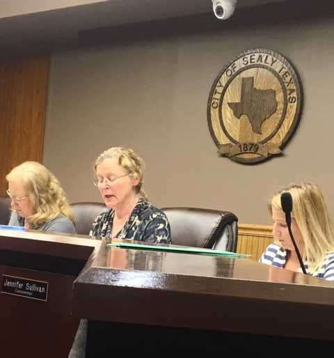 Sealy City Council Mayor Janice Whitehead, left, and Councilwoman Jennifer Sullivan deliberate over impact fees for new development.