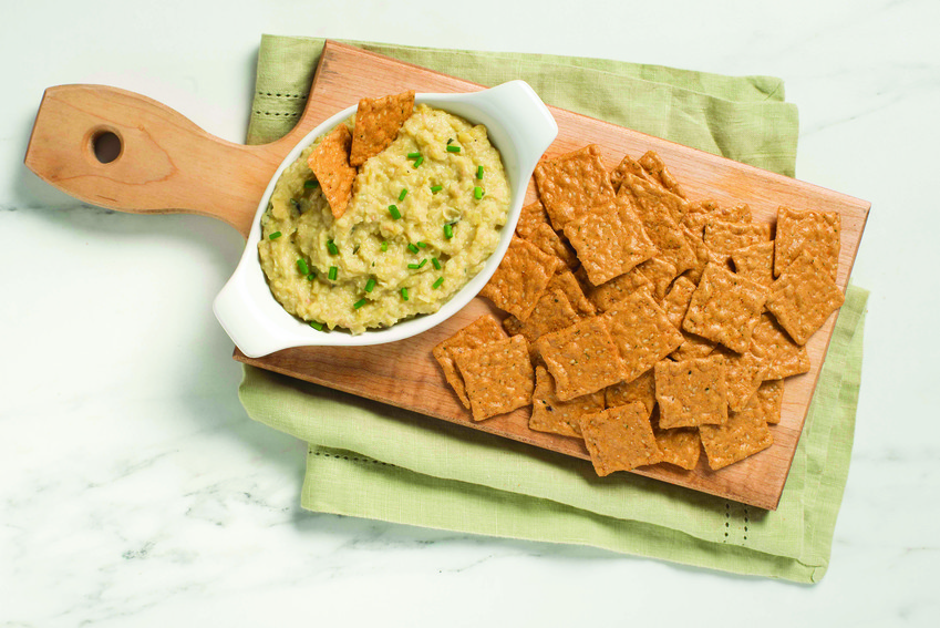 Pictured is baked white bean and artichoke dip with crackers.