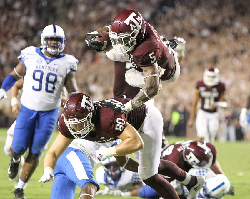 Texas A&M Aggies running back Trayveon Williams (5) dives into the end zone for the game-winning touchdown during overtime of an NCAA football game between Texas A&M and Kentucky on Saturday, Oct. 6, 2018 in College Station, Texas. Texas A&M won, 20-14.