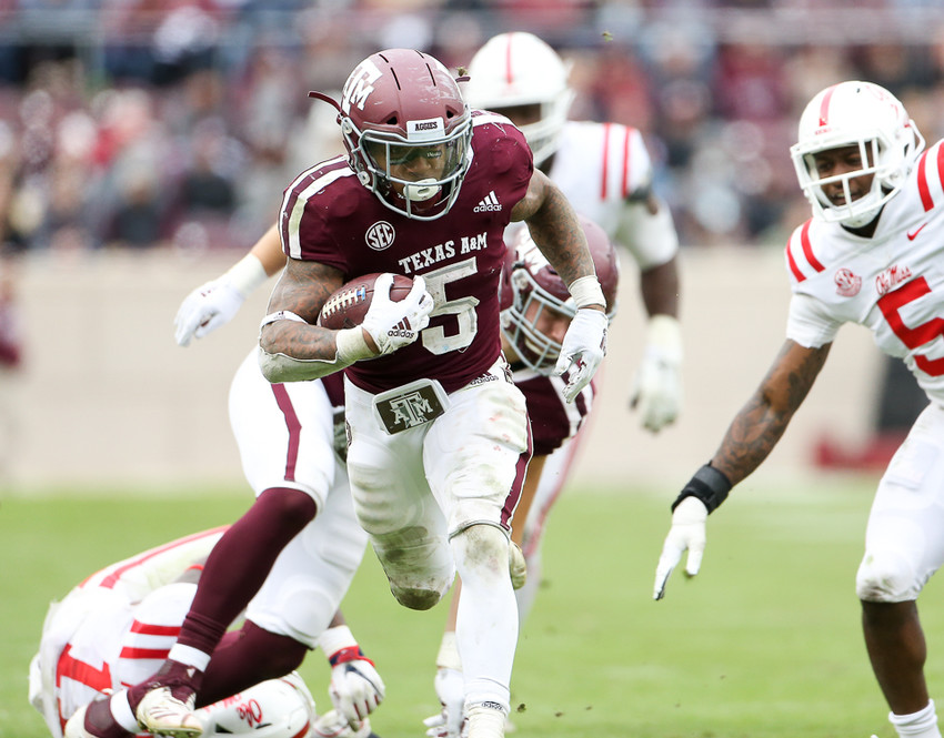 Texas A&M Aggies running back Trayveon Williams (5) carries the ball during the second half of an NCAA college football game between Texas A&M University and the University of Mississippi on Saturday, Nov. 10, at Kyle Field in College Station, Texas.