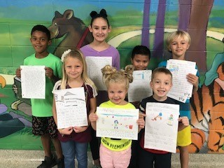 Pictured are the winners of the October essay contest at Maggie B. Selman Elementary School. From left are Aiden Johnson, Alexis Kamenicky, Lauryn Necker, Skylar Parson, Jeffrey Alvarez, Zeke Konvicka and Eddie Hawkes.