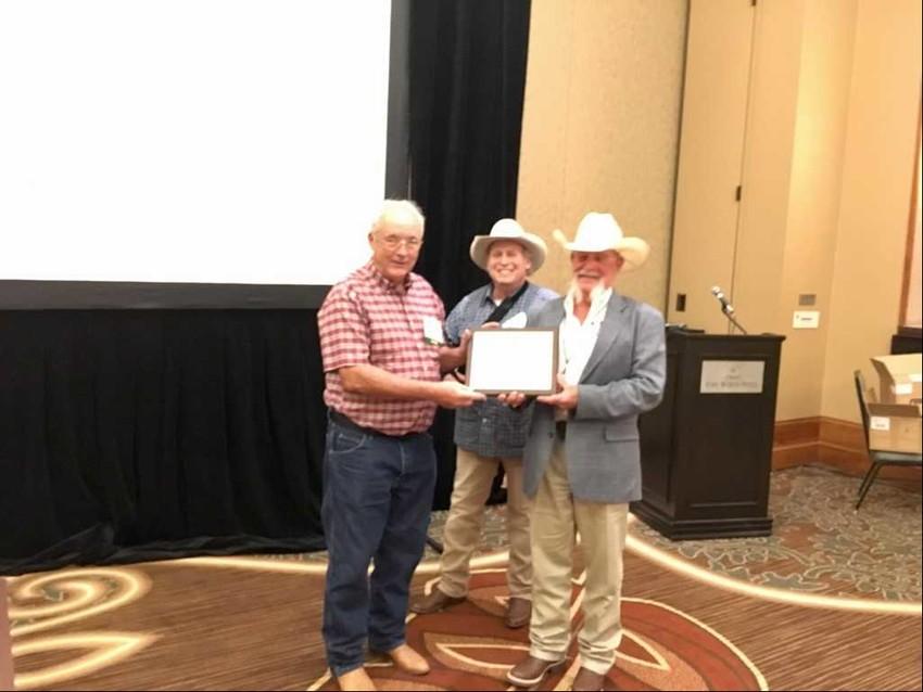 Ira Lapham received an award for 25 years of service as a director for Austin County SWCD No. 347. Jose Dodier, Jr., State Board Chairman, and Rick Schilling, ATSWCD Vice President from Area 3 are pictured along with Ira.