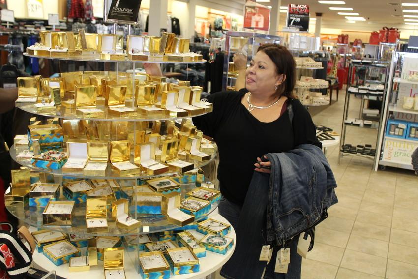 Betty Garza looks for gems at Palais Royal.