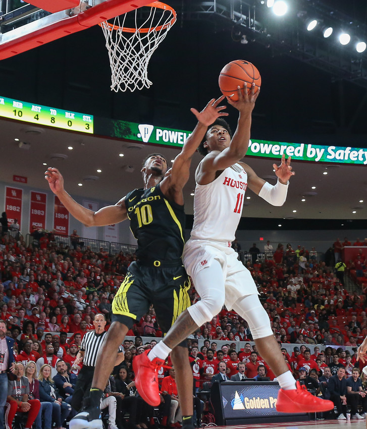 Houston Cougars guard Nate Hinton (11) goes up for a shot against Oregon Ducks guard Victor Bailey Jr. (10) during an NCAA men's basketball game between the University of Houston and the University of Oregon on Saturday, Dec. 1, 2018 in Houston, TX.