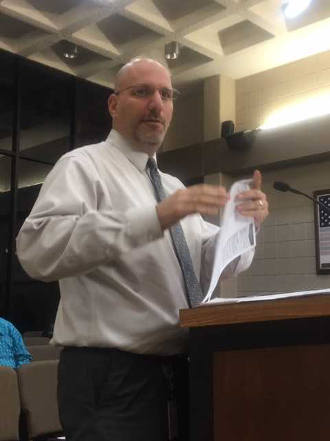 Eric Schulman, director of client services for Entrust, addresses the Sealy City Council during a special meeting Dec. 4.