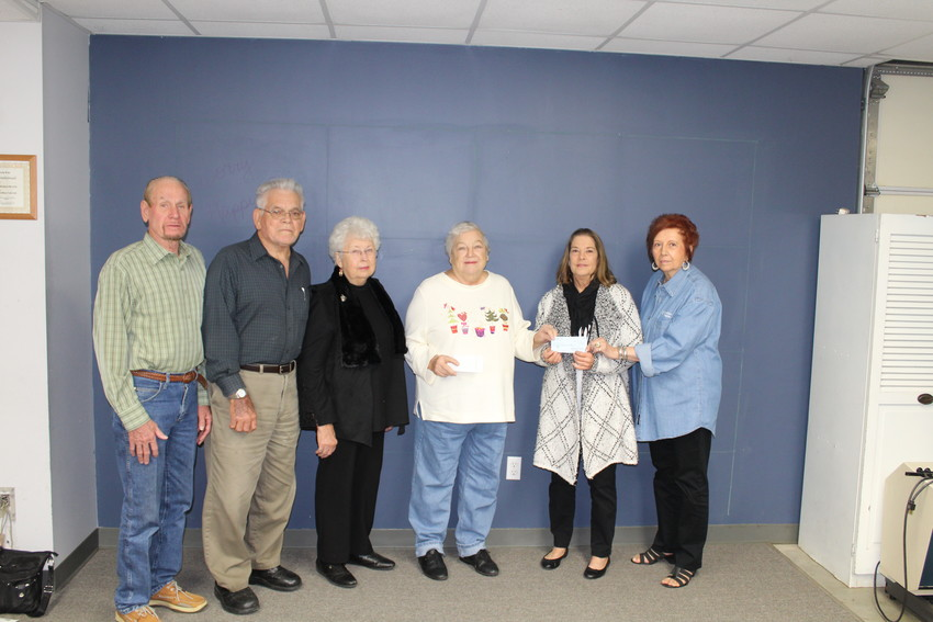 Pictured from left are WoodmenLife Chapter 105 representatives Alton Ehler, Bennie and Bernice Stolarski and Gladys Frank presenting a $500 check to Raising Academic Performance representative Michele Maderer. On the far right is WoodmenLife member Lynn Ehler.