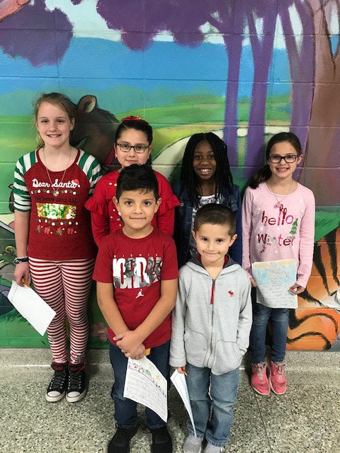 Pictured from left are the Maggie B. Selman Elementary School essay contest winners for the month of December: Larry Solorio, Connor Haidusek, Elizabeth Kamenicky, Cristal Renteria, Khamari Thomas Mitchell and Lainey Siska.
