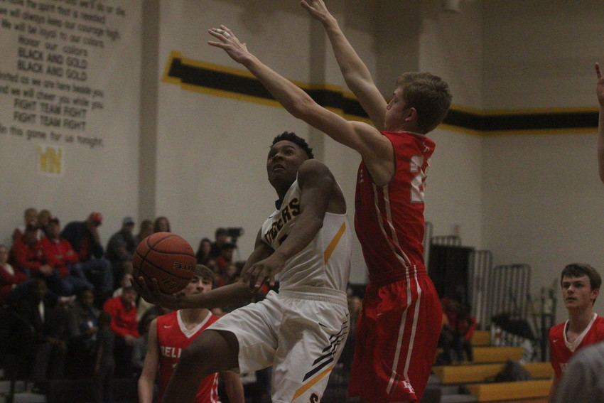 A.J. McGee supplied 20 points to ward off the last-second, near-comeback from rival Bellville.