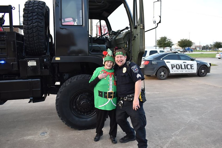 Brigid Stevenson has served as the Sealy Police Department's chaplain since July. Here she dons an elf costume with Patrolman Chad Matura for the Blue Santa delivery of toys to underprivileged children.