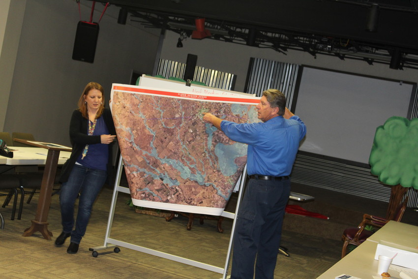 Trica Coronis, representing Christian City Fellowship, and Austin County Emergency Management Coordinator Ray Chislett review maps of local flood hazard zones during a recent meeting of volunteers and emergency management officials.