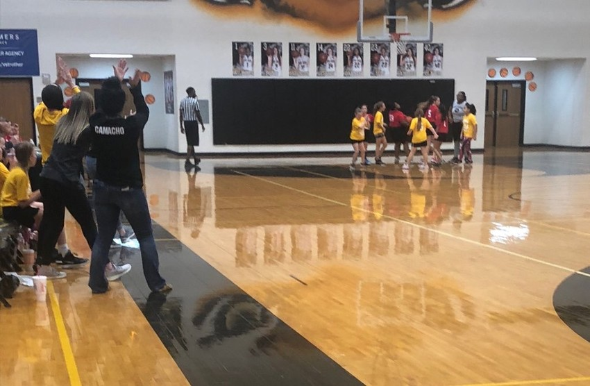 The varsity Lady Tigers took a few hours out of their weekend workouts to trade places with their coach and oversee some Little Dribbler action on the same court they play on.