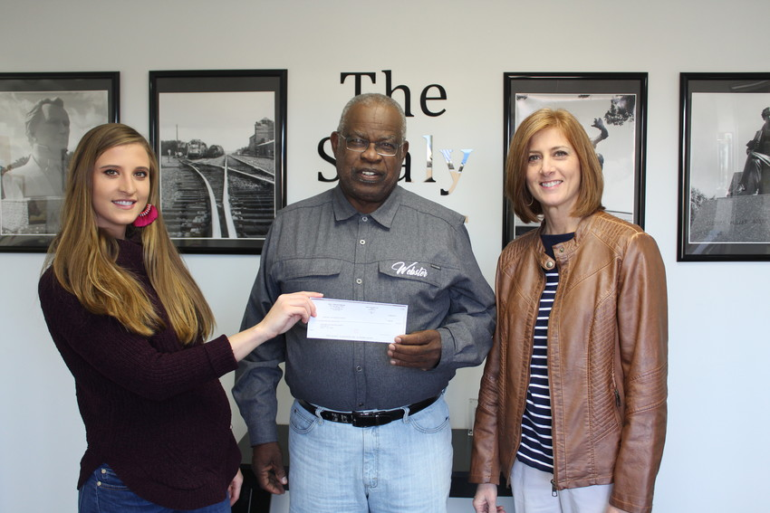 April Towery/Sealy News  Pictured from left are Sealy News bookkeeper Brianna Noviskie, HOA-Meals on Wheels treasurer Charles Webster and HOA-Meals on Wheels secretary Juli Kaase. The Sealy News presented HOA-Meals on Wheels with a check for $544.05 from recycled products donated by residents.