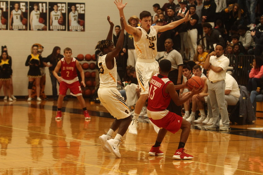 Coach Ray Dabney hopes to take advantage of the remaining home-court advantage the Tigers will have and hopes to see more stifling defense from Aidan Roberts (32) and Draper Parker (15).