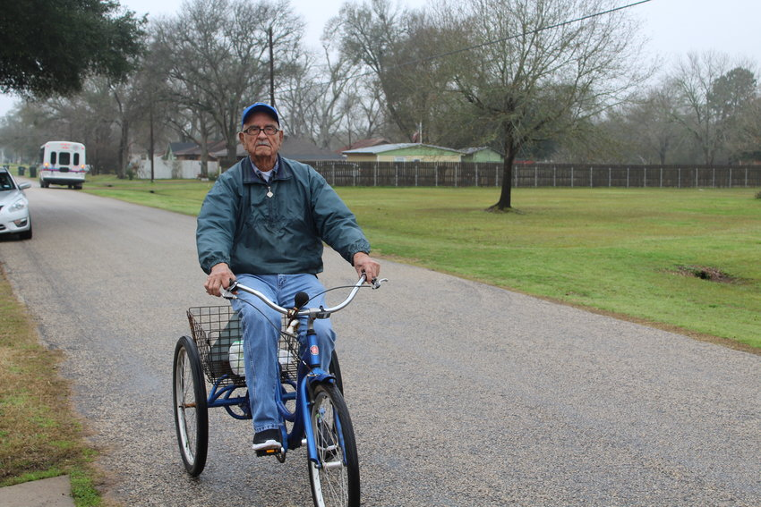 Manuel Resendez rides his bicycle through Sealy every morning.