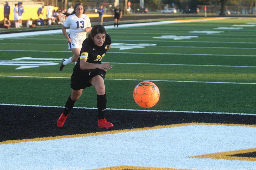 Jessica Vital (20) kept her focus on the ball which helped her record an important goal in the first half against Royal.