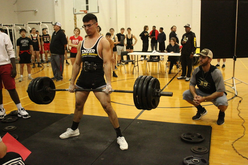 The calm after the storm: Although Gustavo Vital looks quite relaxed at the top of this deadlift, there was plenty of face scrunches and grunts that came before but all is well that ends well as he finished as the top Tiger lifter in Schulenburg.