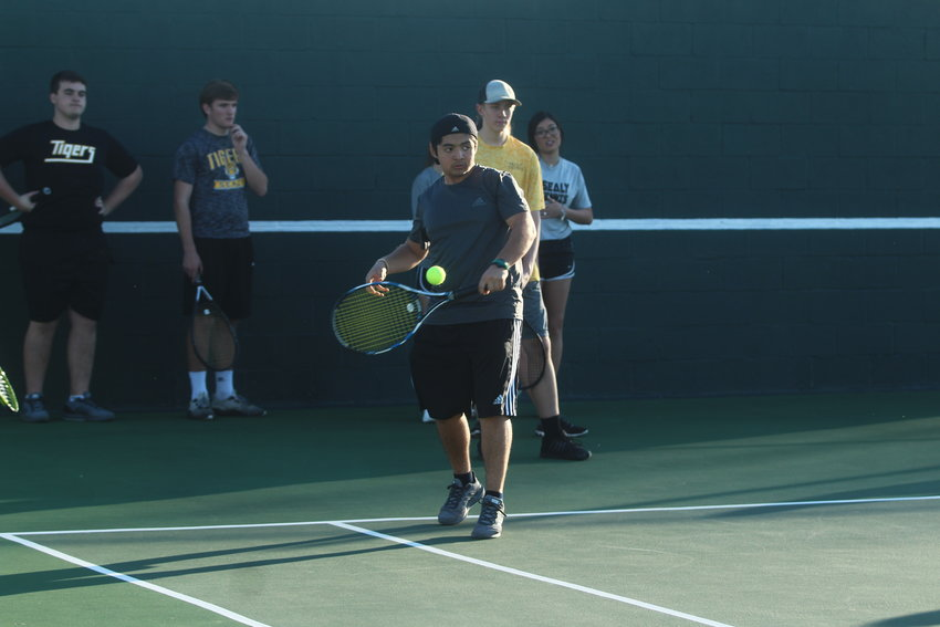 Carlos Godoy (pictured) was a part of the winning efforts for the Tigers on the tennis court in Wharton, earning a mixed-doubles title along with Macey Feland.