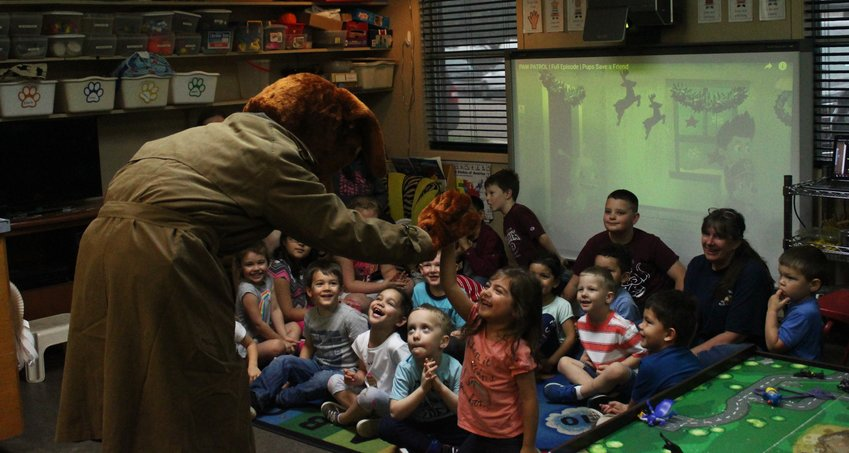 Fred McGruff the crime dog paid a visit to Small World Early Childhood Enrichment Center in Sealy Monday morning to share some tips on how to take a bite out of crime and made some new friends.
