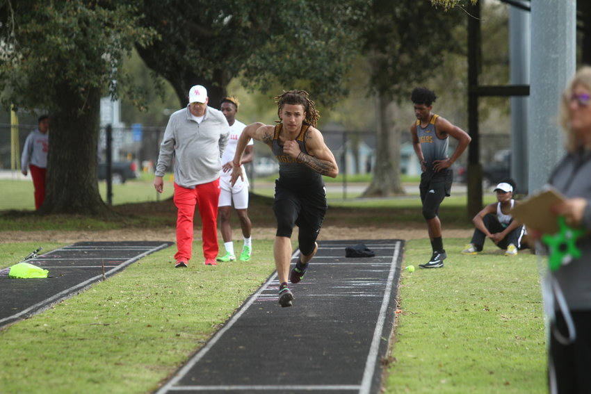 Ivan Bolden spent the first part of his afternoon playing in the sand and came away with first place in both the triple and long jump contests.