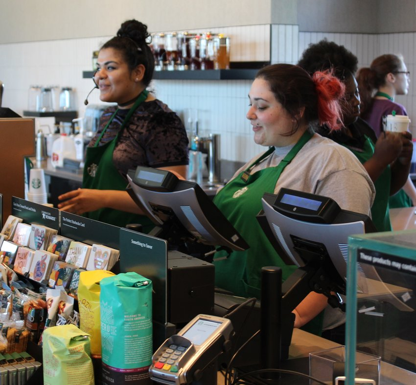 The Starbucks baristas will always be ready to take an order with a smile just as Christina Saenz (left) and Miranda Murray were Monday morning when the new Sealy store opened.